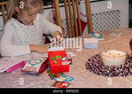 Child writing christmas Cards - Stock Photo