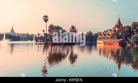 Karaweik on Kandawgyi lake in Rangon - Stock Photo