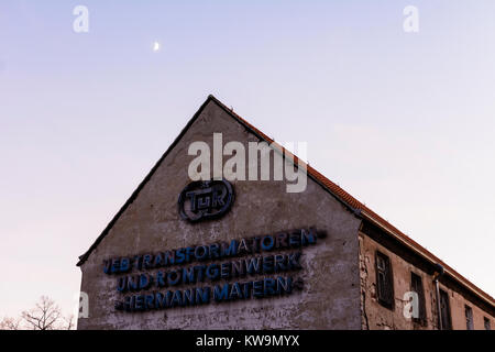 old factory from GDR times sign 'VEB Transformatoren- und Röntgenwerk Hermann Matern, TuR' - Stock Photo