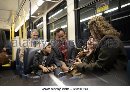 Latino family riding bus - Stock Photo