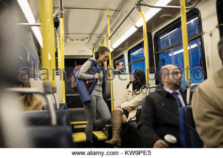 Female commuters talking on bus - Stock Photo