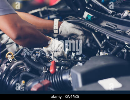 Hands of auto mechanic repairing car. Selective focus. - Stock Photo