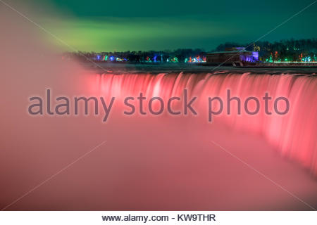 Horse Shoe Falls Niagara Falls Ontario Canada at night with red lights on the falls. - Stock Photo