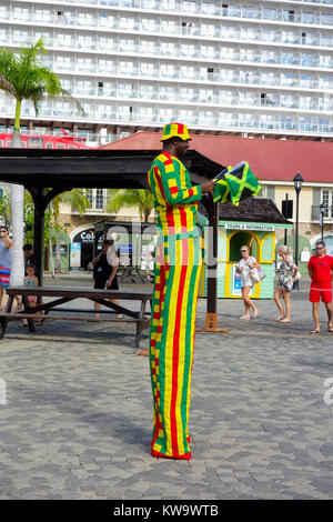 Performing man on Stilts - Falmouth Cruise Port, Jamaica. - Stock Photo