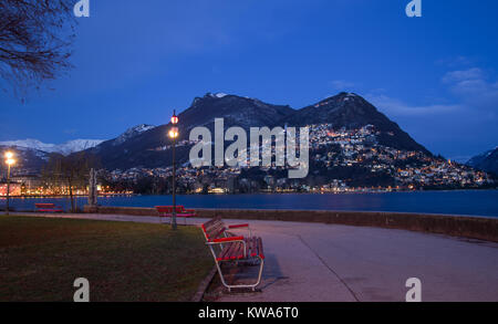 healthy walk early in the morning on the lakefront,to start the day in the best way. Lugano, Switzerland. - Stock Photo