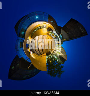 Little planet panorama of modern glass architecture with bridges crossing a street and a staircase in the center - Stock Photo
