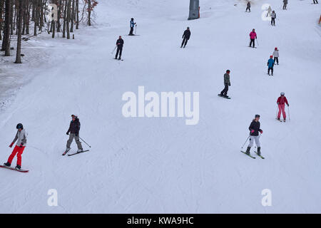 WINTERBERG, GERMANY - FEBRUARY 16, 2017: Many skiers and snowboarders on a piste at Ski Carousel Winterberg - Stock Photo