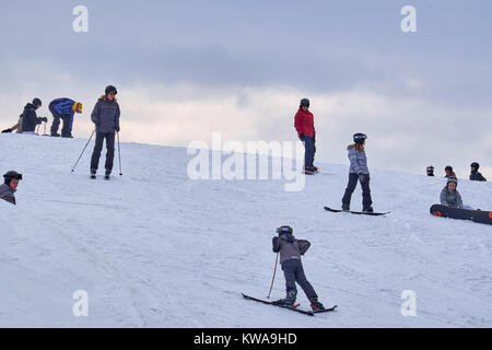 WINTERBERG, GERMANY - FEBRUARY 16, 2017: Group of young skiers on skis and snowboards at Ski Carousel Winterberg - Stock Photo