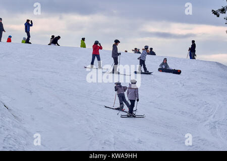 WINTERBERG, GERMANY - FEBRUARY 16, 2017: Many people on skis and snowboards on a mountain top at Ski Carousel Winterberg - Stock Photo