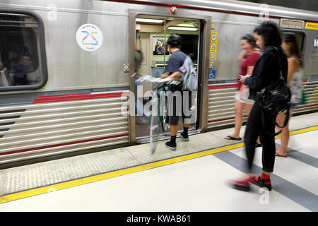 People waiting for a train inside Pershing Square Metro underground station in downtown Los Angeles, California - Stock Photo