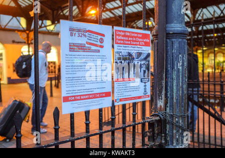 Brighton, UK. 2nd Jan, 2018. Protest posters outside Brighton railway station this morning against the rail fare - Stock Photo