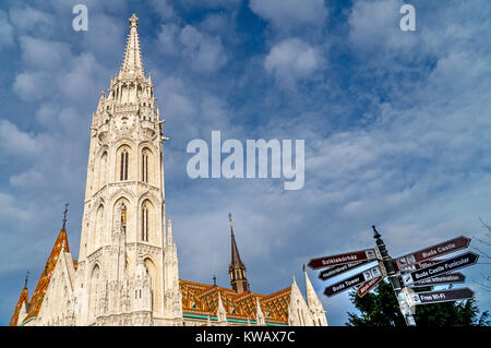 Signposts with Matthias Church, Roman Catholic church located in Budapest Hungary. - Stock Photo