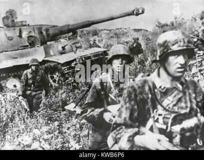 German Infantry in camouflaged clothing retreating with a tank on the Kuban Front. German troops held the Kuban - Stock Photo