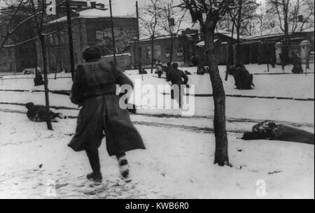 Soviet(Russian) soldiers engaged in hunting down German stragglers in Rostov-on-Don, Russia. During a German retreat - Stock Photo