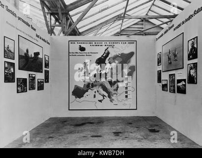 Nazi anti-Semitic propaganda in a 1934 photo exhibit about various European 'races'. In center is a map identifying - Stock Photo