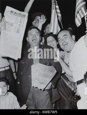 Chinese newspaper vendor, among crowd waving American flags in Chinatown, New York, on V-J Day. 'The China Tribune', - Stock Photo