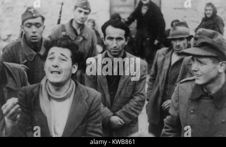 Soviet (Russian) civilians arrested by German as partisans in 1944. German photo caption describes them as 'captured - Stock Photo