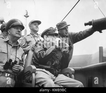 U.S. Commanders observe the shelling of Inchon, Korea, from the U.S.S. Mt. McKinley. Front row, L-R: Brig. Gen. - Stock Photo