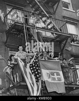 Italian Americans celebrating the armistice between Italy and the Allies. They wave American and Italian flags from - Stock Photo