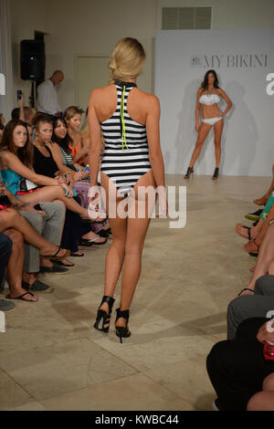 MIAMI BEACH, FL - JULY 19: A model walks the runway at the MY BIKINI fashion show during Mercedes-Benz Fashion Week - Stock Photo