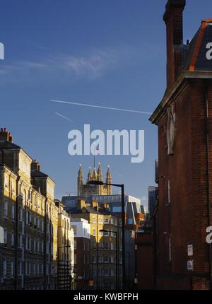Cityscape along a London Street Looking Towards Victoria Tower, Palace of Westminster, UK, Under a Blue Sky. - Stock Photo