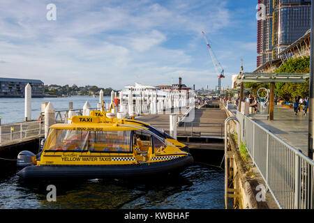 Yellow water taxi moored at Cockle Bay in Darling Harbour (Harbor), Sydney, Australia - Stock Photo