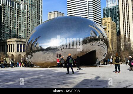 Cloud Gate (also known as The Bean and The Kidney Bean) sculpture in Millennium Park is a tourist attraction even - Stock Photo