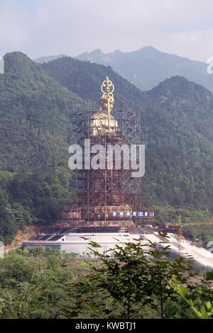 New statue of buddha Di Zang nesr Jiuhua Shan village, China - Stock Photo