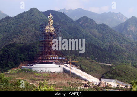 New statue of buddha Di Zang near Jiuhua village, China - Stock Photo
