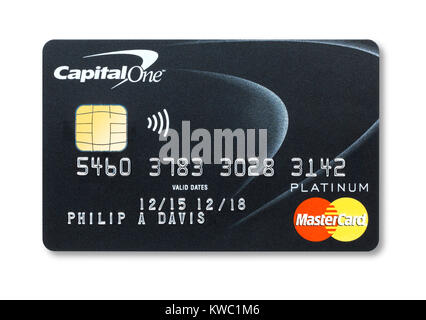 Simple cut out of a Capital One credit card with holding shadow - Stock Photo