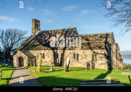 St Peter's Church in the village of Heysham, Lancashire, England. It is recorded in the National Heritage List for - Stock Photo