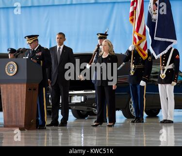 President Barack Obama holds hands with Sec. of State Hillary Rodham Clinton at Andrews Field, MD. On Sept. 14, - Stock Photo