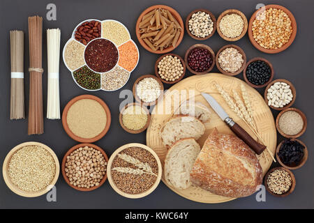 Dried macrobiotic diet health food concept with sourdough bread, soba and udon noodles, legumes, seaweed, grain, - Stock Photo