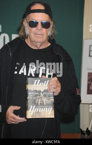 NEW YORK, NY - OCTOBER 14: Neil Young signs copies of his new book 'Special Deluxe: A Memoir Of Life And Cars' at - Stock Photo