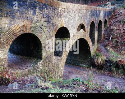 Looking along the seven arch bridge in the gardens of Rivington Pike, Lancashiew - Stock Photo