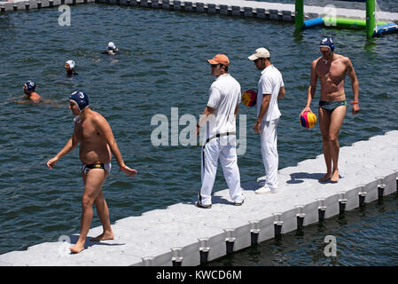 Waterpolo players and referees on Cape Town Harbour, Western Cape, South Africa, December 2017. - Stock Photo