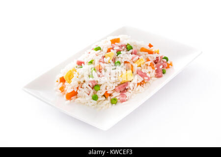 Chinese fried rice with vegetables and omelette isolated on white background - Stock Photo