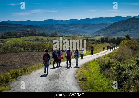 Volterra, Pisa, Italy - November 1, 2017: Hikers depart from Saline for the Volterra hills with panoramic views - Stock Photo