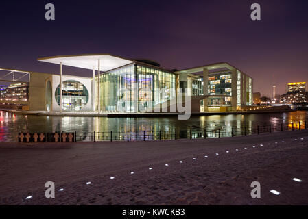 The Marie-Elisabeth-Lueders-Haus which is part of the government district in Berlin, Germany at night. - Stock Photo