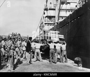 American-made truck lowered from a freighter at Piraeus as part of a relief effort to Greece. U.S. aid supported - Stock Photo