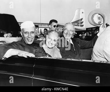 Prime Minister Jawaharlal Nehru of India and President Harry Truman in open car. Between them is Nehru's sister, - Stock Photo