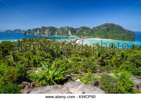 Koh Phi Phi Don Viewpoint showing Tonsai Bay (left), Loh Dalam Bay (right) and Phi Phi Ley (far left) - Thailand - Stock Photo