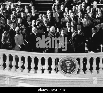 President John Kennedy takes the oath of office administered by Chief Justice Earl Warren. Jan. 20, 1961. - (BSLOC - Stock Photo
