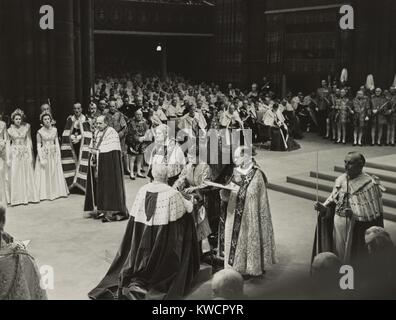 Coronation ceremony of Queen Elizabeth II, June 2, 1953. She is receiving the Spurs of Chivalry from the Lord Great - Stock Photo