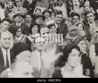 Al Capone (center), seated in front of three women, watching a college football game. He sits with other fans at - Stock Photo