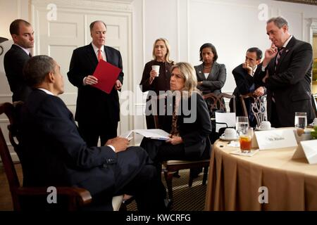 President Barack Obama meets with advisors before a meeting with PM David Cameron of Britain. Waldorf Astoria Hotel - Stock Photo