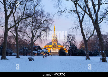 LONDON, ENGLAND: Royal Albert Hall and Albert Memorial in snow from Kensington Gardens - Stock Photo