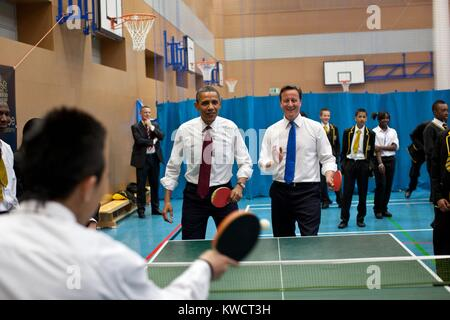 Barack Obama and BP Minister David Cameron play table tennis with Globe Academy students in London. May 24, 2011 - Stock Photo