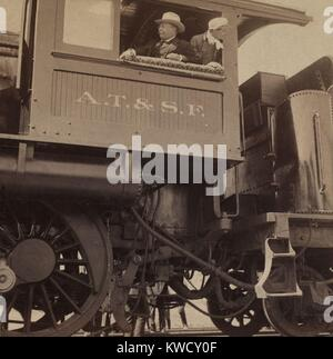 Theodore Roosevelt in the cab of an Atchison, Topeka, and Santa Fe Railroad Company locomotive, May 7, 1903. During - Stock Photo