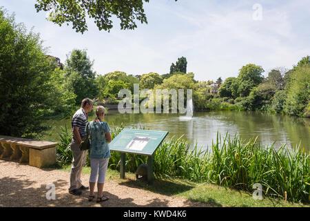 Couple by The Lake, Bletchley Park, Sherwood Drive, Bletchley, Milton Keynes, Buckinghamshire, England, United Kingdom - Stock Photo
